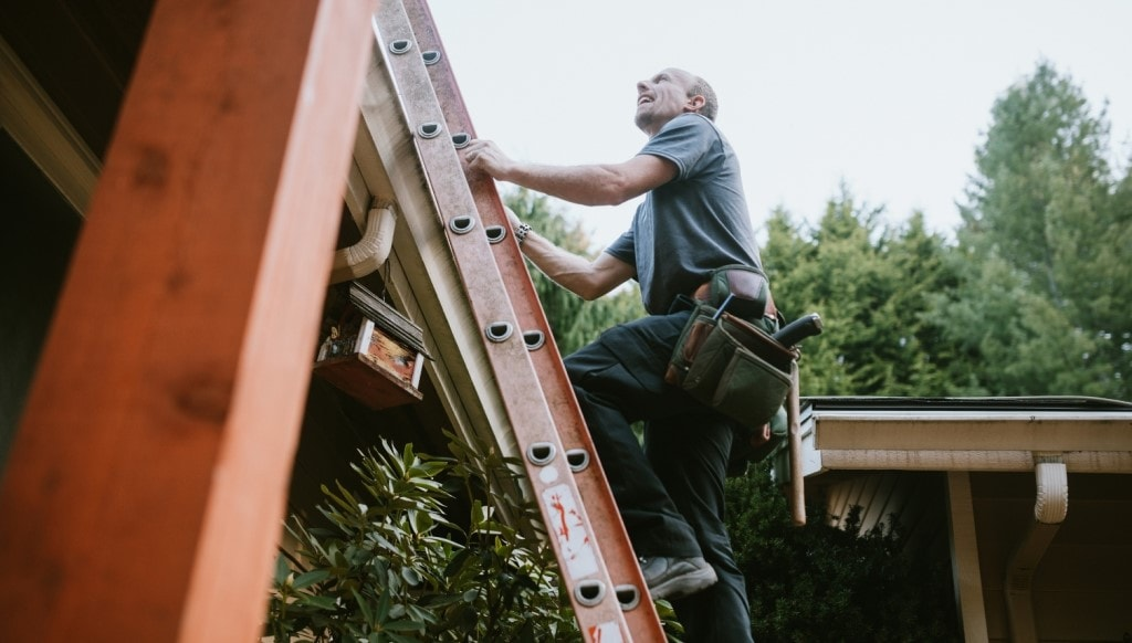 Contractor Inspecting Roof