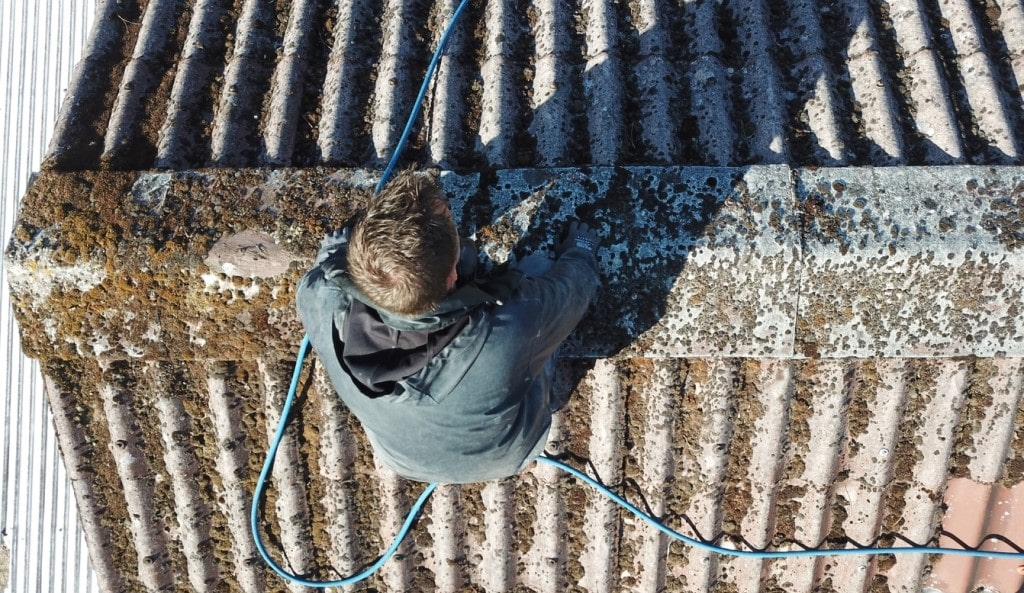 Man Cleaning Roof